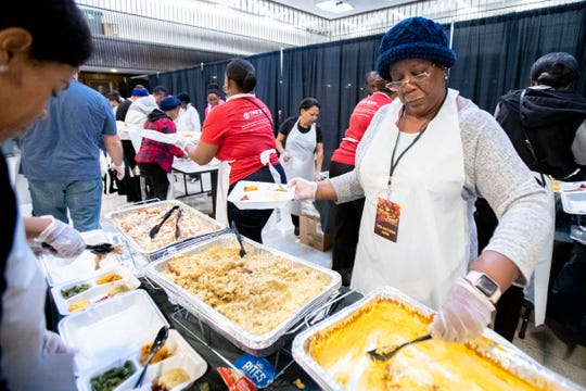 Deborah Thomas plates meals Thursday, Nov. 28, 2019, during the city's MemFeast Thanksgiving meal at City Hall in downtown Memphis.