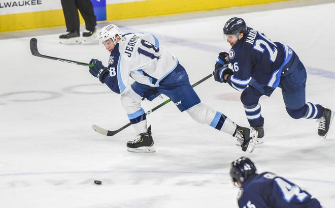 Left wing Tanner Jeannot, left, and the Admirals finished the pandemic-shortened 2019-20 season with an AHL-best 41-14-5-3 record.