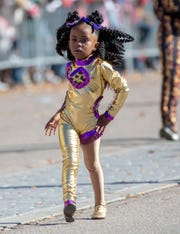 A diva in training gives some sass as she marches down Dexter during the Turkey Day Classic Parade.
