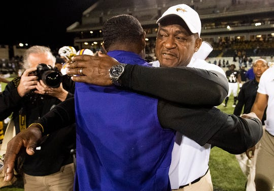 Alabama State head coach Donald Hill-Eley hugs Prairie View head coach Eric Dooley after the Turkey Day Classic on the ASU campus in Montgomery, Ala., on Thanksgiving Day, Thursday, November 28, 2019.