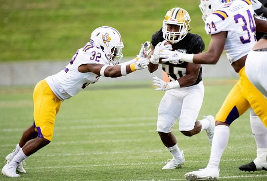 Alabama State running back Ezra Gray (20) fights for yardage against Prairie View in second half action of the Turkey Day Classic on the ASU campus in Montgomery, Ala., on Thanksgiving Day, Thursday, November 28, 2019.