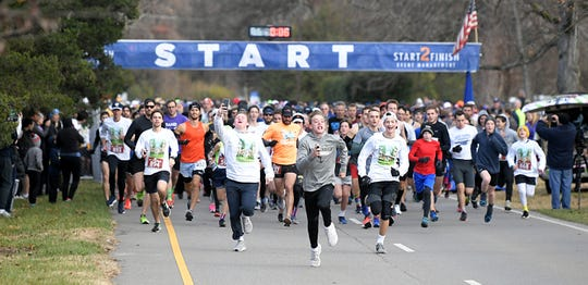 People run in the 2019 Boulevard Bolt on a 5-mile course on Belle Meade Boulevard in Nashville on Thursday, Nov. 28, 2019.  This is the 26th anniversary of this annual Thanksgiving Day event.