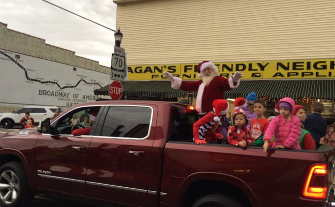 Santa Claus waves at the Dickson Christmas Parade crowd in 2018.