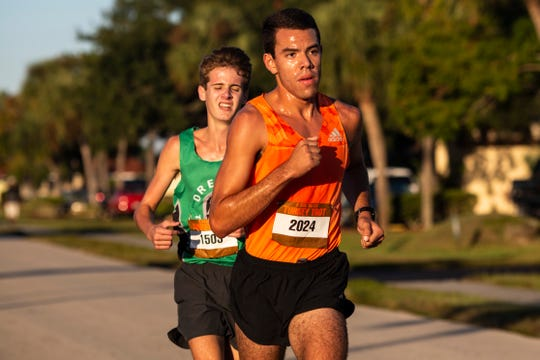 Franklin Caceres, right, and Colsen Palmer, left, win 1st and 2nd place in the 40th Annual Turkey Trot 5K race on Thursday, Nov. 28, 2019, in Cape Coral.