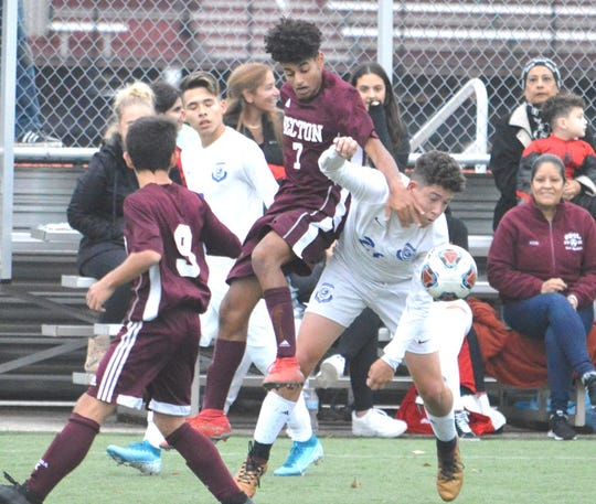 Becton senior Ibrahim Regal (center) battling with North Arlington senior Jaden Seguera (right).