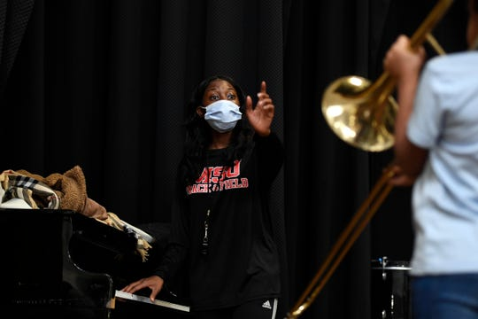 Monae Clancy of Paterson teaches middle schoolers the notes on trombone on Monday, Nov. 25, 2019, just two days before the All City Band debut at the Thanksgiving Classic football game. Clancy, a Rosa Parks High School alum, is now studying music education at Montclair State University.