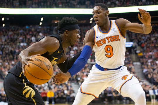 Toronto Raptors Terence Davis (left) drives at New York Knicks RJ Barrett during first half of an NBA basketball game in Toronto on Wednesday, Nov. 27, 2019.