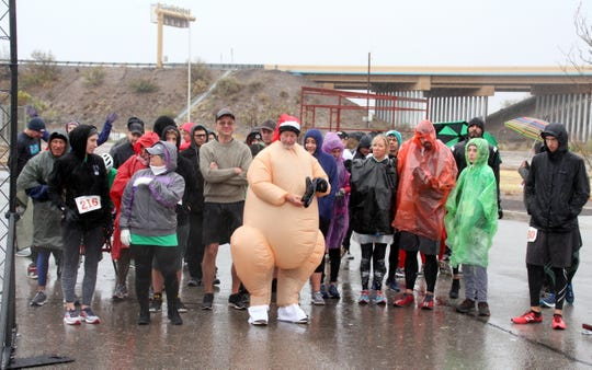 Mark Schultze makes his appearance - complete in turkey suit - during the 2019 Ultimate Fitness Turkey Trot.