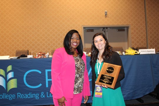Alicia Romero (right), a senior at New Mexico State University, accepted the 2019 College Reading & Learning Association's Outstanding Mentor award from Ashley Lewis, a CRLA representative, at the organization's annual conference in New Orleans, Louisiana. She was honored for her work as a TRIO Student Support Services peer mentor at NMSU.