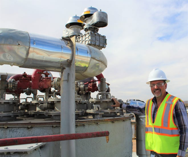 LCU Deputy Director Wastewater, John Mrozek, stands on top of the new piping connected to the heating water jacket. This is where methane is pumped from the digester and fuels the co-generation system that helps power the JHWWTF.