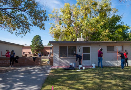 Volunteers painted 24 homes in the Tom Fort Village during the New Mexico State University Student Veterans Housing project Nov. 9.