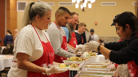 Volunteers at The Salvation Army's annual Thanksgiving luncheon at the Farmington Civic Center on Thanksgiving Day, Nov. 28, 2019.