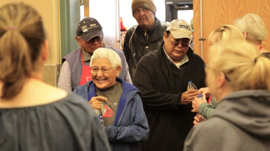 Volunteers greet community members at The Salvation Army's annual Thanksgiving luncheon at the Farmington Civic Center on Thanksgiving Day, Nov. 28, 2019.