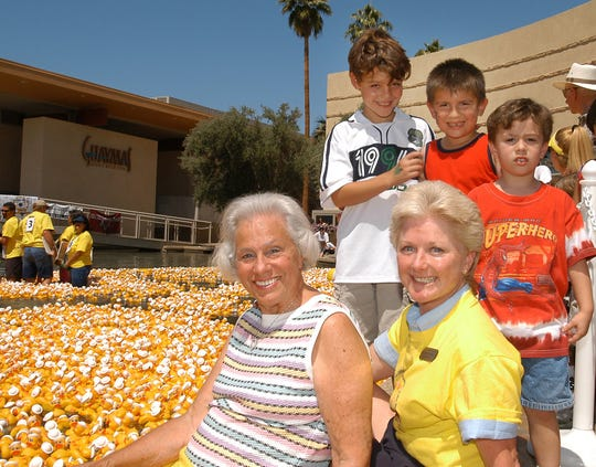 Betty Barker, front left, with Children's Discovery Museum Executive Director Lee Vanderbeck and some young visitors to the museum in 2004.