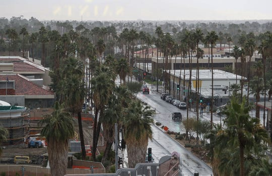 Rain showers create a dreary sky above downtown Palm Springs on Thanksgiving Day as seen from the top of Kimpton Rowan Palm Springs Hotel, November 28, 2019.
