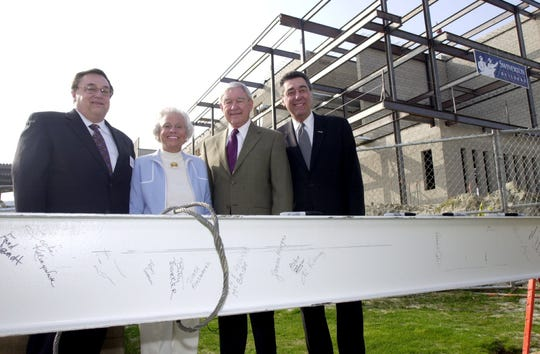 In 2004, the last steel girder for new Cal State San Bernardino Palm Desert Campus building was hoisted into place. Marking the milestone were Fred Jandt, dean of the school, Betty Barker, Dick Oliphant and Al Karnig, president of Cal State.