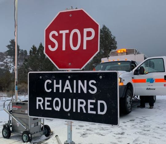 A Caltrans photo from Nov. 27, 2019 shows a sign warning drivers entering Inland Empire mountains. A winter storm hit the region and dropped several inches of snow.
