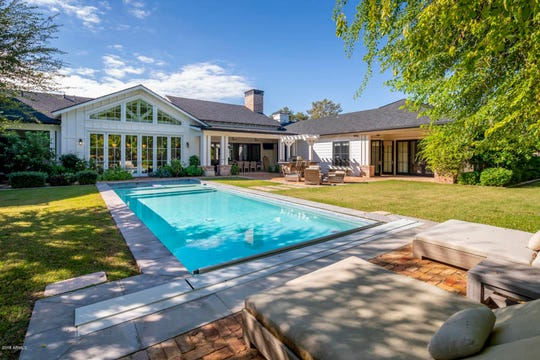 The $3.2M estate, purchased by Lance and Shonda Freeman, has a lap pool and lush landscaping.