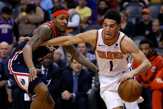 Phoenix Suns guard Devin Booker (1) in the second half during an NBA basketball game against the Washington Wizards, Wednesday, Nov. 27, 2019, in Phoenix. The Wizards defeated the Suns 140-132. (AP Photo/Rick Scuteri)