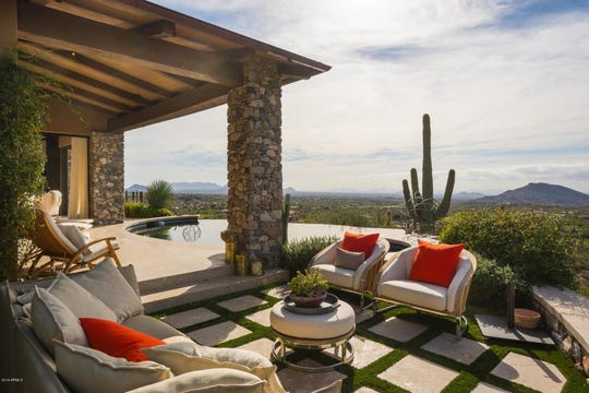 Mark Gilbert and Karen Simmonds paid $5.1 million for a golf course lot mansion in Scottsdale.