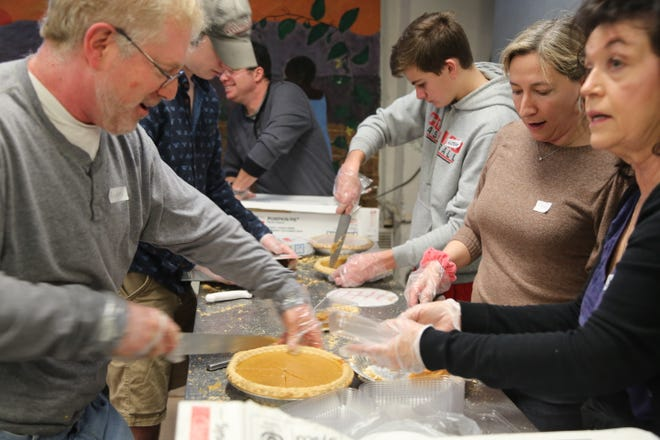 Volunteers serve food at the annual Eileen Hickey Thanksgiving dinner at The Lunch Box in the City of Poughkeepsie on Nov. 28.