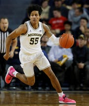 Spring Grove High School graduate Eli Brooks, seen here in action earlier this season, matched his career high with 24 points on Thursday to help unbeaten Michigan upset No. 6 North Carolina.