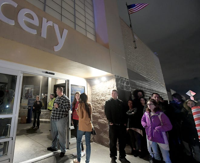 Under emergency lighting, shoppers wait to enter the West Manchester Town Center Walmart after power went out at the mall for about 30 minutes during the Thanksgiving Day shopping rush Thursday, Nov. 28, 2019. Shoppers were not allowed to enter the store during the outage. Bill Kalina photo