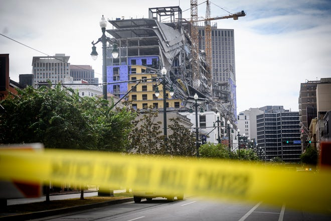 The Hard Rock Hotel partially collapsed onto Canal Street downtown New Orleans, Louisiana on October 12, 2019. One person died and at least 18 others were injured Saturday when the top floors of a New Orleans hotel that was under construction collapsed, officials said.The New Orleans fire department received reports at 9:12am local time that the Hard Rock Hotel in downtown New Orleans had collapsed. (Photo by Emily Kask/AFP via Getty Images/TNS)