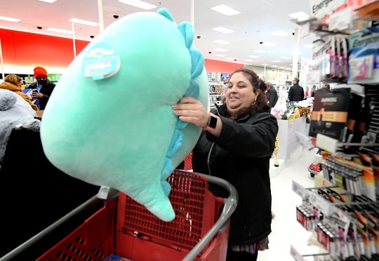 Brittany Barakat of York City plops a Squishmallow toy into her cart while shopping at the West Manchester Township Target for holiday deals on Thanksgiving Day Thursday, Nov. 28, 2019. She said the gift was for her son. Bill Kalina photo