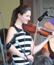 """""""Fiddlin'"""" is playing at Small Star Art House."""
