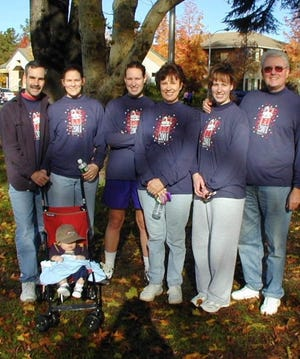 The family in 2001: Jack Masterson, in stroller, and his family prepare for the Redding Turkey Trot.