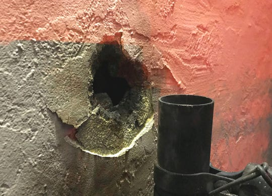 A streak of lightning burned a hole in the outside wall of a home on Riverview Drive during a thunderstorm Wednesday night, Nov. 27, 2019, in Redding.