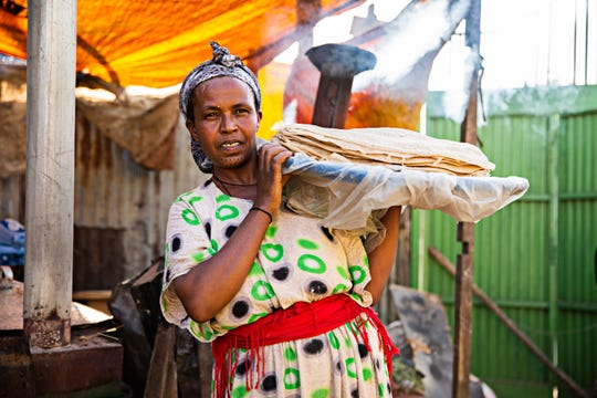 The flatbread known as injera is a staple of life in Ethiopia. Teru, a participant in the Women's Empowerment program, makes and sells this flatbread by the stack. Tanzania, 2016, Women's Empowerment.
