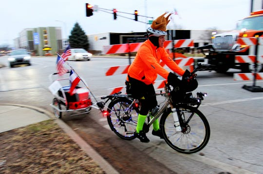 Bicycle escort Dale Nimmo arrives before the 25th annual Turkey Trot 5K kicks off Nov. 28, 2019 in Springfield, Mo.