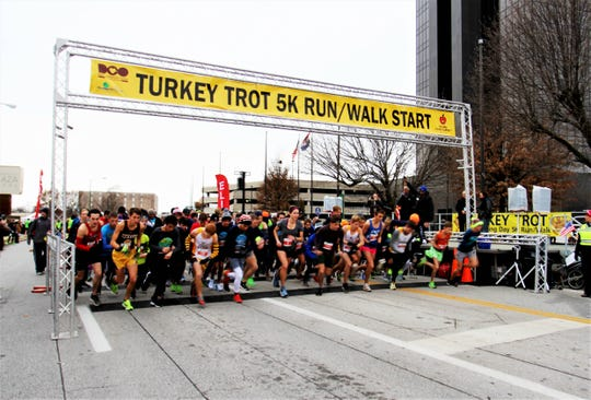 The elite running group takes off after the starting gun fires during the Turkey Trot 5K on Nov. 28, 2019, in Springfield, Mo.