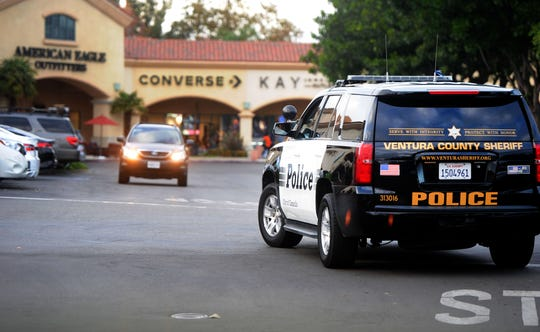 A Ventura County Sheriff's Office vehicle drives around the parking at the Camarillo Premium Outlets, a hub of Christmas shopping in Ventura County.