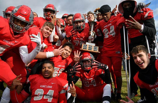 Vineland celebrates after defeating Millville on Thanksgiving Day. The Fighting Clan topped the Thunderbolts 27-26 at Wheaton Field on Thursday, Nov. 28, 2019.