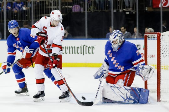 New York Rangers goaltender Henrik Lundqvist (30) stops a shot on goal by Carolina Hurricanes' Sebastian Aho (20) during the first period of an NHL hockey game Wednesday, Nov. 27, 2019, in New York.