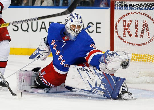 Nov 27, 2019; New York, NY, USA; New York Rangers goaltender Henrik Lundqvist (30) makes a glove save against the Carolina Hurricanes during the first period at Madison Square Garden.