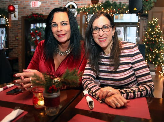 Angelique Piwinski, a local historian takes Lohud's food and dinning reporter Jeanne Muchnick on a food tour of Main Street in Yonkers Nov. 26, 2019.  The two are pictured at Francey Brady's Bar and Grill.