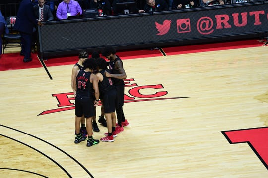 Rutgers basketball team huddles up against UMass.