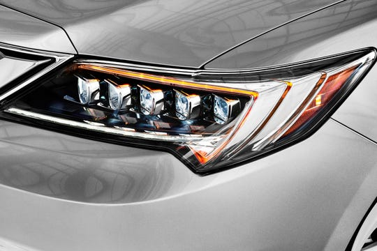 This undated photo provided by Acura shows its innovative jewel-eye LED headlights offered on the ILX sedan. LED and HID headlights produce brighter, sharper and more natural-colored light and use less energy than traditional halogen lights. (American Honda Motor Co. via AP)