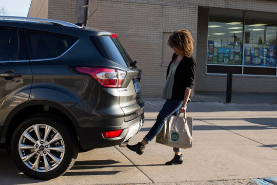 This undated photo provided by Ford shows the hands-free-opening liftgate for the Escape SUV. Power liftgates come in handy but are largely offered as a feature on an upper trim level or an extra-cost option on wagons and SUVs. (Ford Motor Co. via AP)