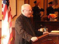 Monsignor Phillip Lowery speaks at a swearing-in ceremony for Ocean County Prosecutor Bradley Billhimer.