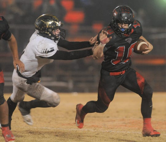 Strawn spread back J.W. Montgomery carries the ball against Gordon in the Region III-1A Division II final Thursday, Nov. 28, 2019, at Hico Tiger Stadium.