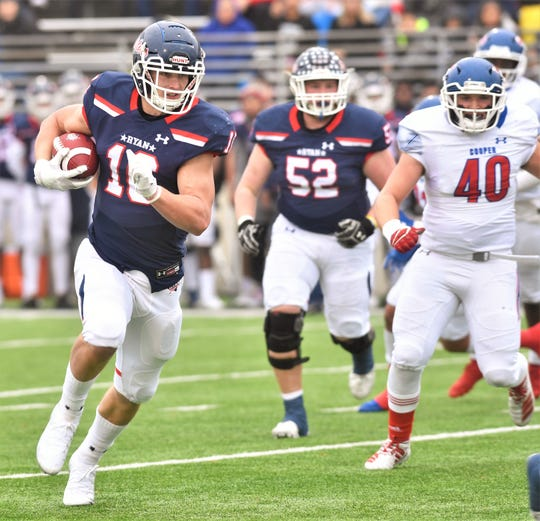 Denton Ryan's Drew Sanders (16) runs for a 32-yard touchdown. Sanders' TD tied the game at 7 with 6:47 left in the first quarter of the Region I-5A Division I semifinal playoff game Friday, Nov. 29, 2019, at C.H. Collins Complex in Denton.