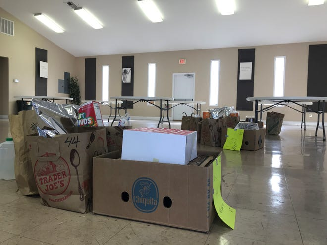 Just two meal remained inside the Calvary Worship Center community room after volunteers delivered 105 meals to homes across Madison County Nov. 27.