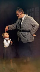 Agatha Trunchbull (Justin Lynn) keeps a watchful eye on Amanda (Willow Erdman).