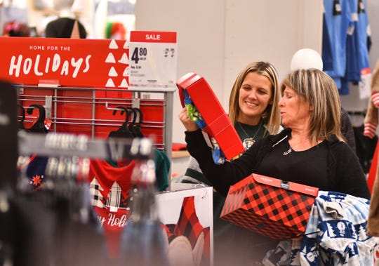 Courtney Gatchell and her mom Shannon Gatchell started shopping at 2:00 a.m., and were still going strong at 11:00 a.m, stopping at the Penneys at Merritt Square Mall. Black Friday actually started on Thursday for many stores and shoppers looking for deals, but shoppers were out in force Friday morning taking advantage of doorbuster and Black Friday sales.