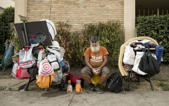 Coy Featherston, 68, who has been homeless since 1995, sits with all his belongings on the sidewalk across from the University of Texas in Austin on Tuesday September 10, 2019.